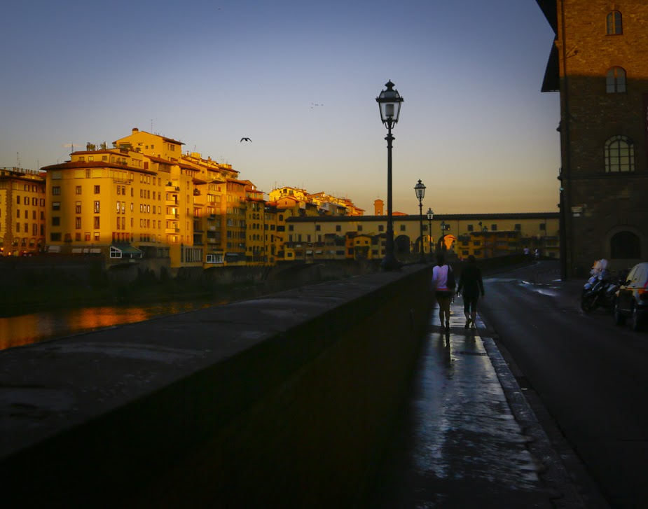 Hannah & Meg Walking on the Arno in Florence