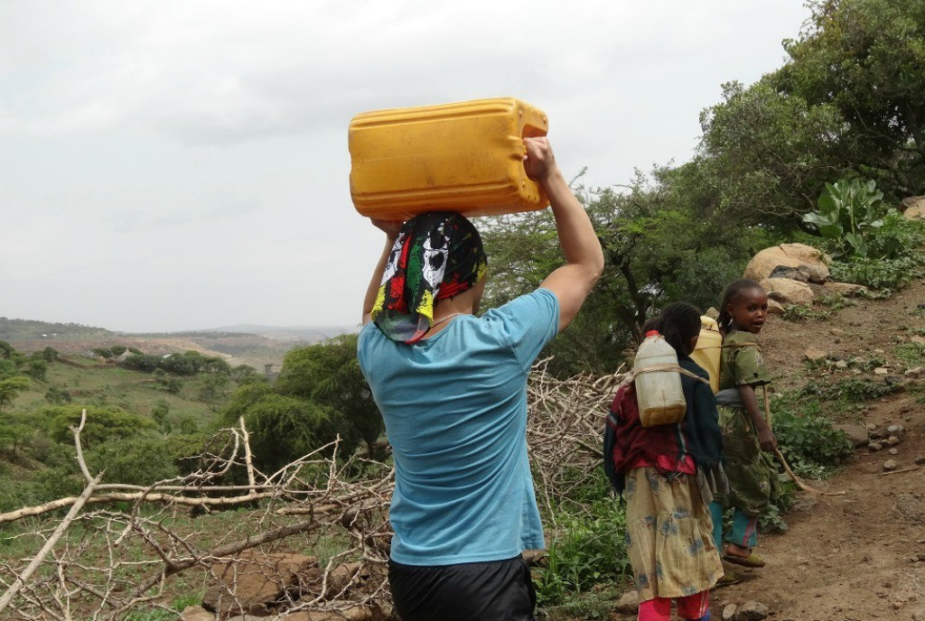 Helping locals carry their water in Ethiopia